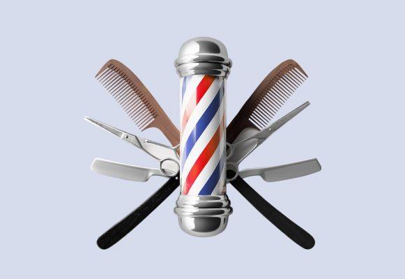 peine, tijera y máquina de afeitar detrás de un poste de barbero